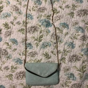 Mint green crossbody bag.